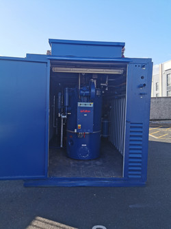Fully packaged 320Kg/hr Nat gas fired mobile steam boiler house.jpg