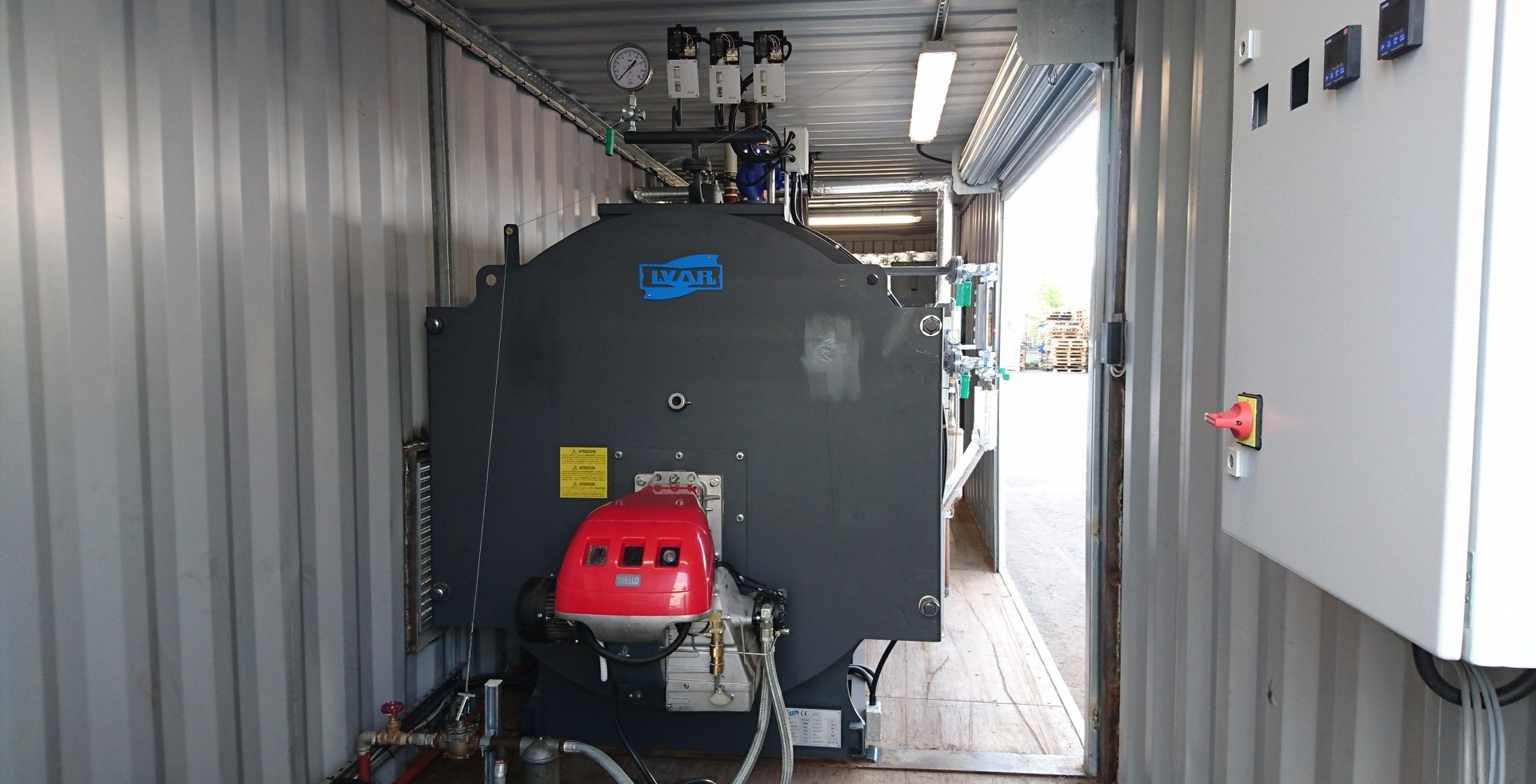 Industrial boiler in containerised boiler house.jpg