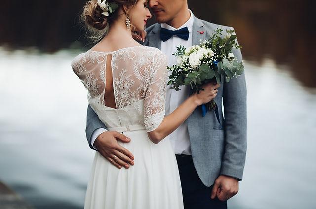 crop-of-elegant-newlyweds-near-the-lake.jpg