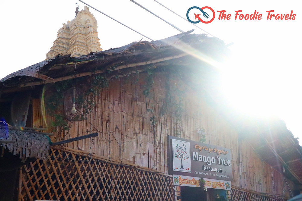 Outside view of Mango Tree Restaurant & Virupaksha Temple