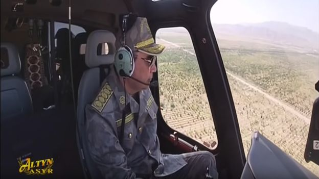 Turkmen Leader Flying a Helicopter