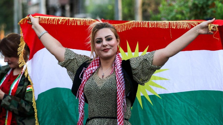 Woman Holding a Kurdish Flag
