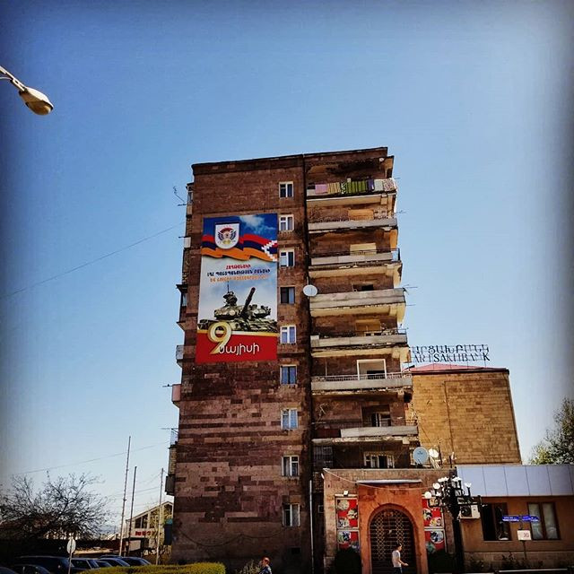 Apartment building in Artsakh (Nagorno-Karabakh), depicting a tank and 9 years of independence and the flag of Artsakh