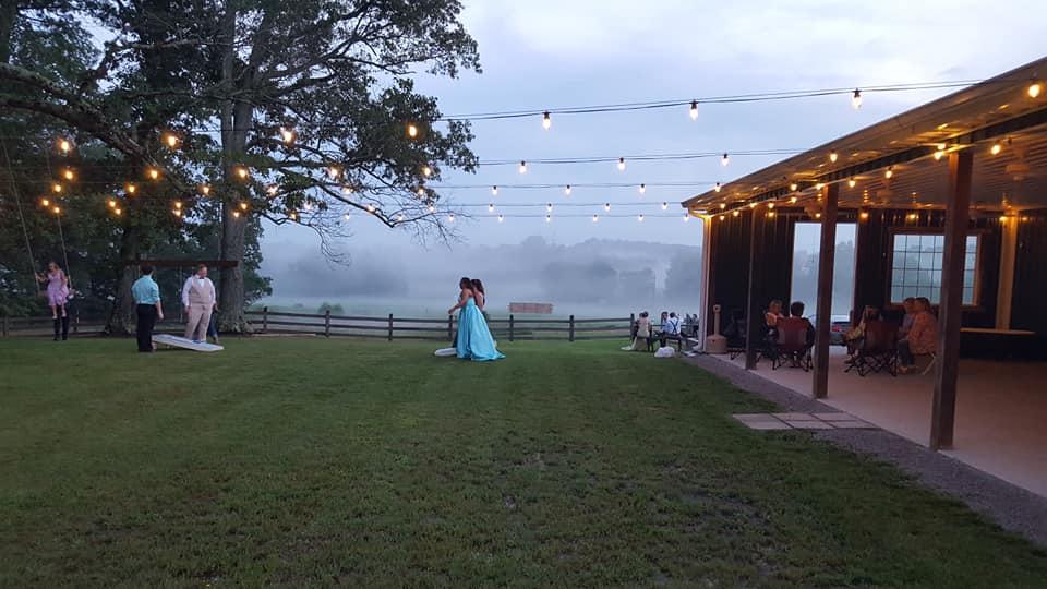Prom cornhole - swinging - fog.jpg