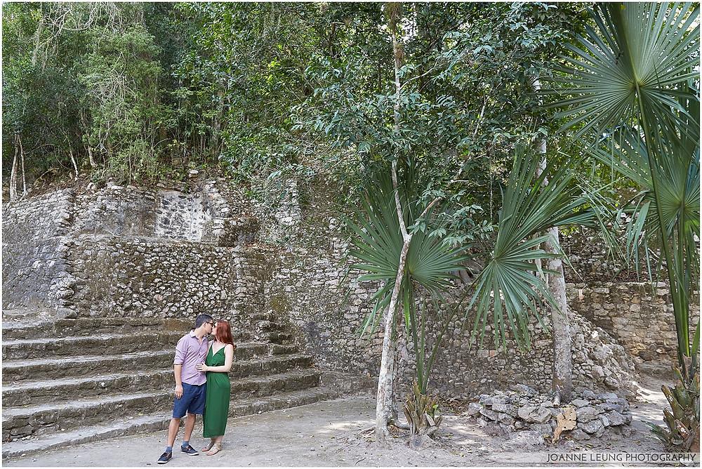tulum pyramid couple kissing fiji fan palm