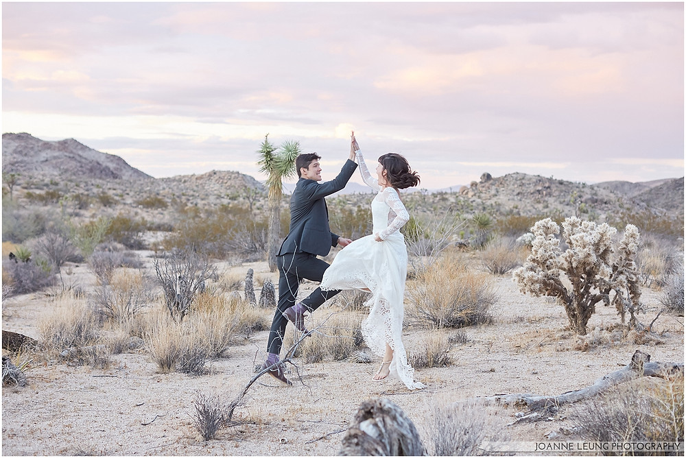 Joshua Tree Live Oak Wedding untraditional nature rocks amazing bridal portrait kiss sunset old oak tree wedding posing jumping high five