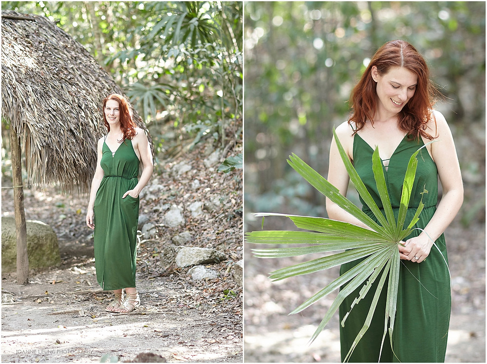beautiful red head posing with giant leaf
