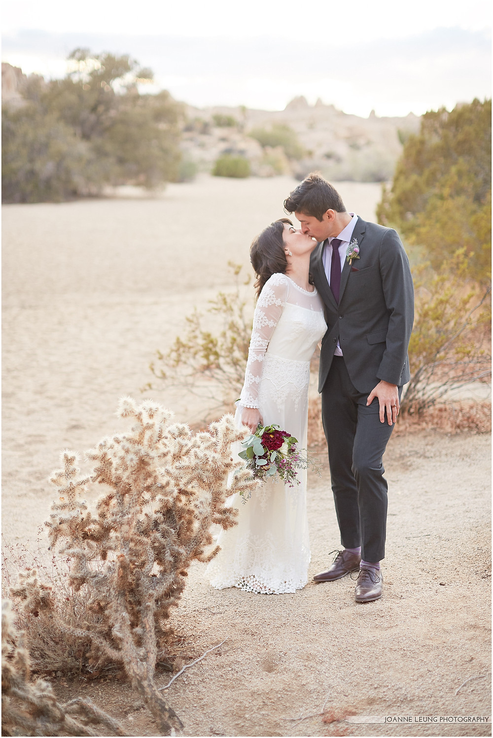 Joshua Tree Live Oak Wedding untraditional nature rocks amazing bridal portrait kiss sunset