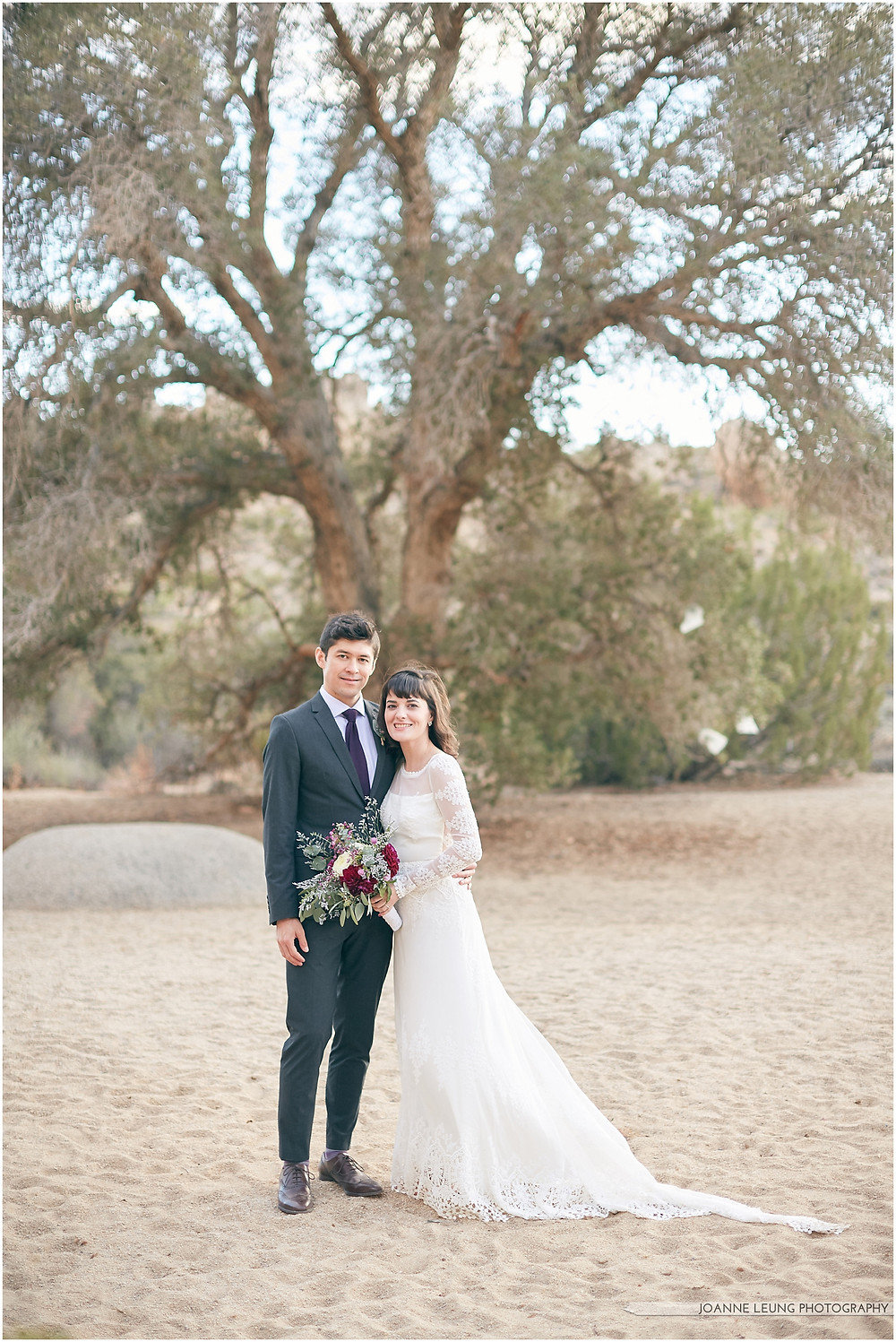 Joshua Tree Live Oak Wedding untraditional nature rocks amazing bridal portrait kiss sunset old oak tree wedding posing
