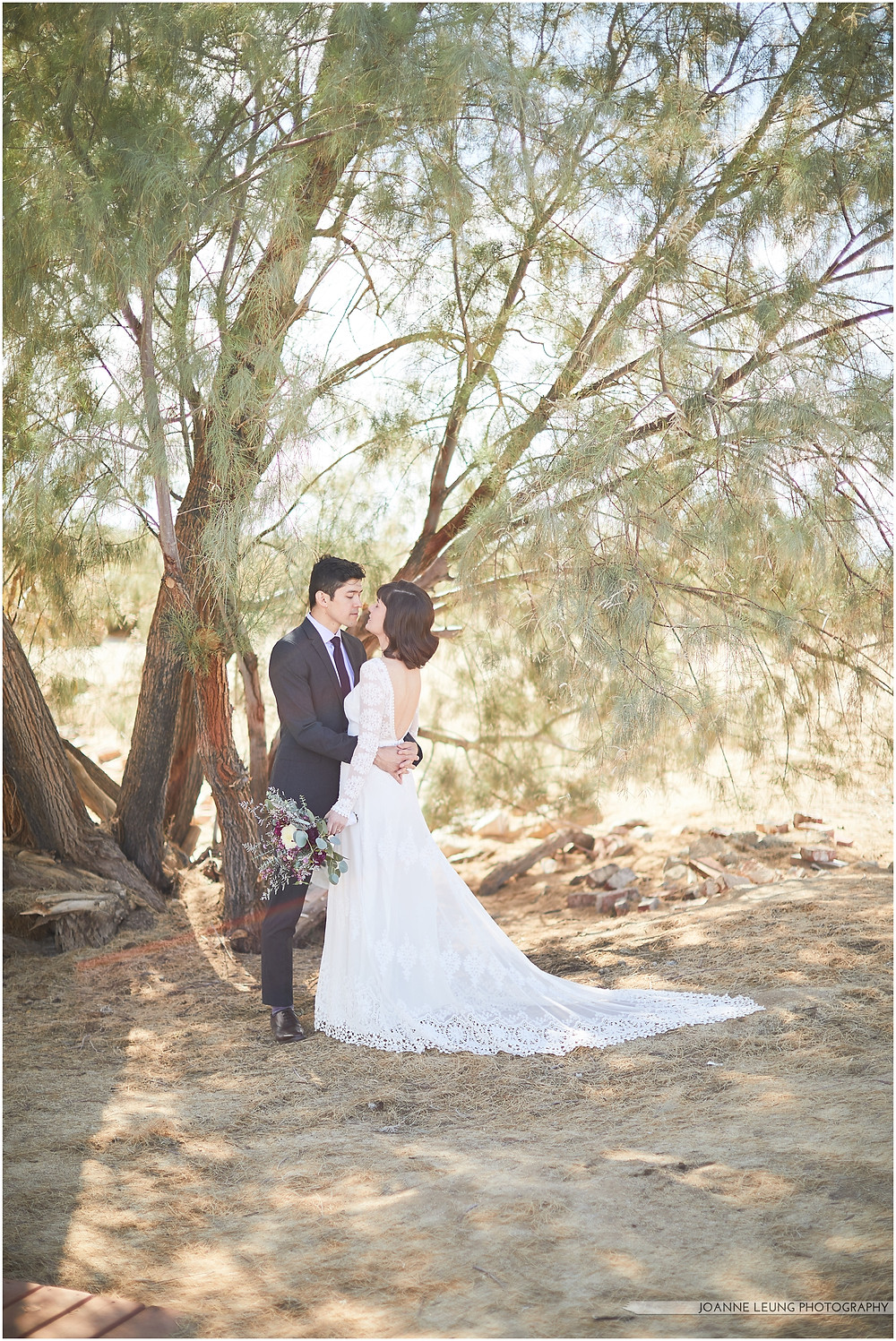Joshua Tree Live Oak Wedding beautiful backless lace wedding dress bride and groom