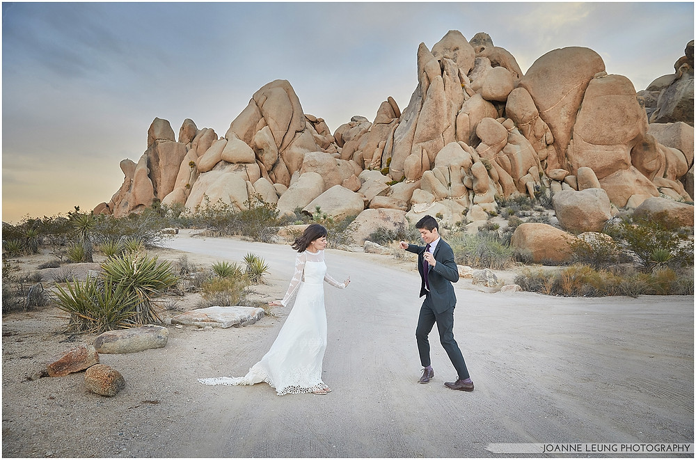 Joshua Tree Live Oak Wedding untraditional nature rocks amazing bridal portrait kiss sunset old oak tree wedding posing dance off fun