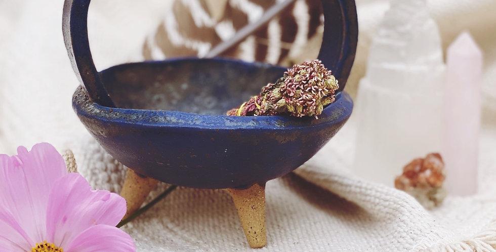 cauldron in sapphire smoke