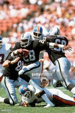 Autographed photo of Greg Bell with the Raiders