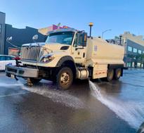 A flusher truck on Folsom St.