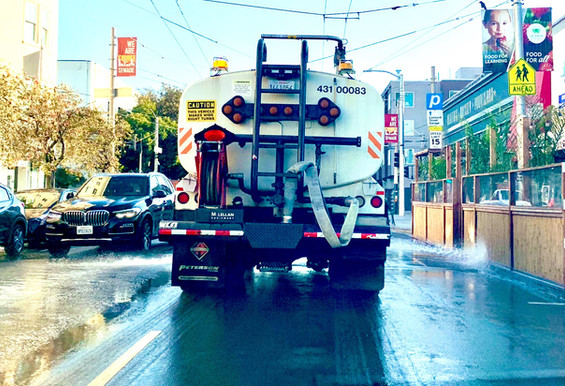 Our flusher truck washes down Chestnut Street.
