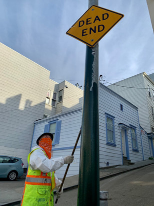 Yizheng Yu, from our graffiti crew, paints out tags in North Beach.