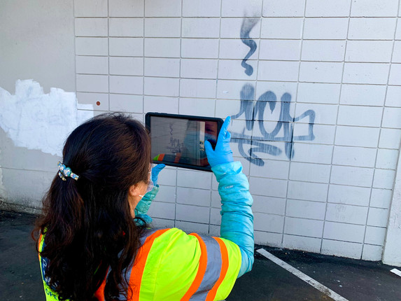 Graffiti inspector Lifang Zhang  documents tags on private properties and works with the owners to get them removed.