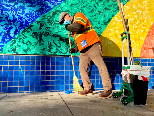 Street sweeper Demian Mouton knows the corner of Cole & Haight well. The midwife who delivered him painted this famous rainbow mural, and as a boy he lived in an apartment above. Today, he's part of our CleanCorridorsSF team deep-cleaning the neighborhood.