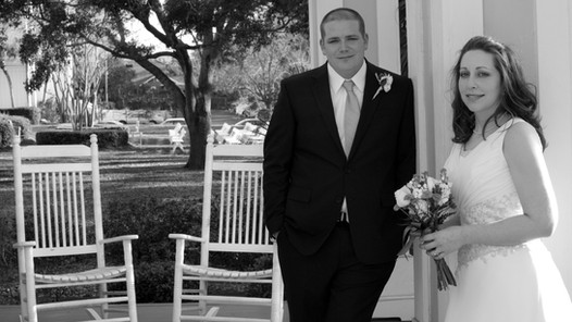 Bride and groom with rocking chairs