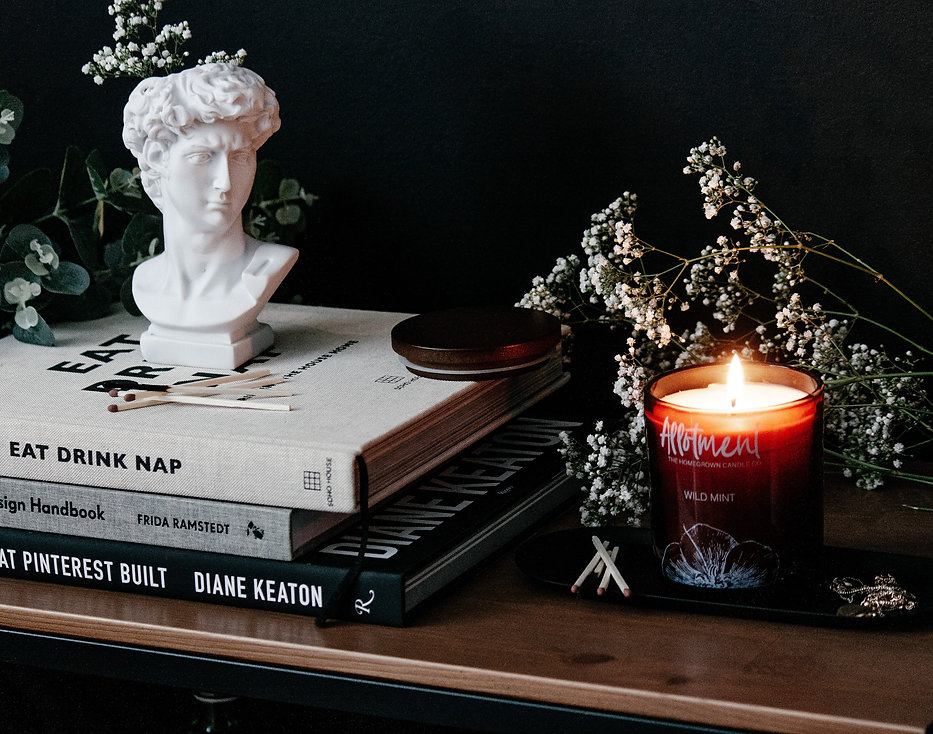 lit_candles_beside_marble_bust.jpg