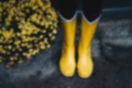 photo-of-yellow-boots-near-mums