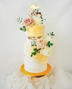 Semi-naked cake with fluffy blooms & sub