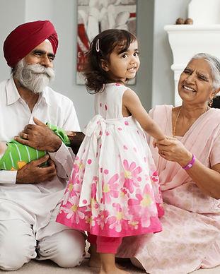 Grandparents talking with their grandchildren