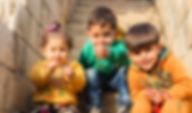 three-children-sitting-on-stairs-1212805