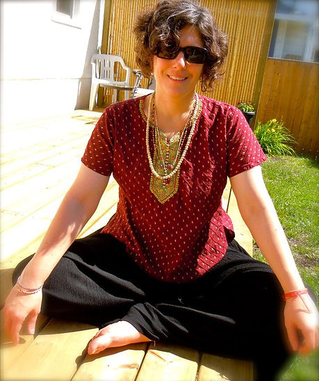 Spiritual Coach, Healer and Intuitive Reader, Christine, sitting outside