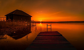 red-sunset-with-house-and-docks.jpg