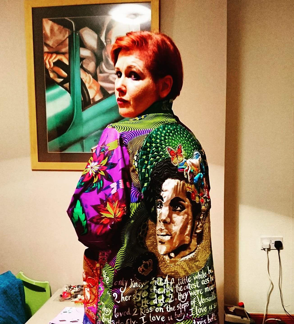 Woman wearing a Prince themed handmade art kimono