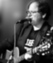 Jeff_withGuitar_rev1_BlurredBkgrnd_gray.