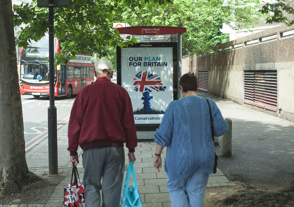 Tories out bus stop poster campaign
