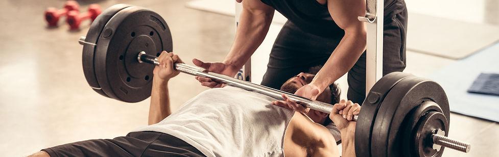 bigstock-Athletic-Trainer-Helping-Sport-