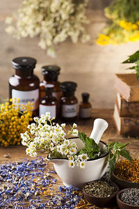 Natural medicine on wooden table backgro