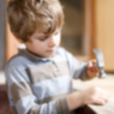 happy little kid boy helping with toy to