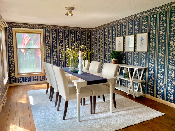 Wallpapered Dining room brightened with home staging Swampscott MA