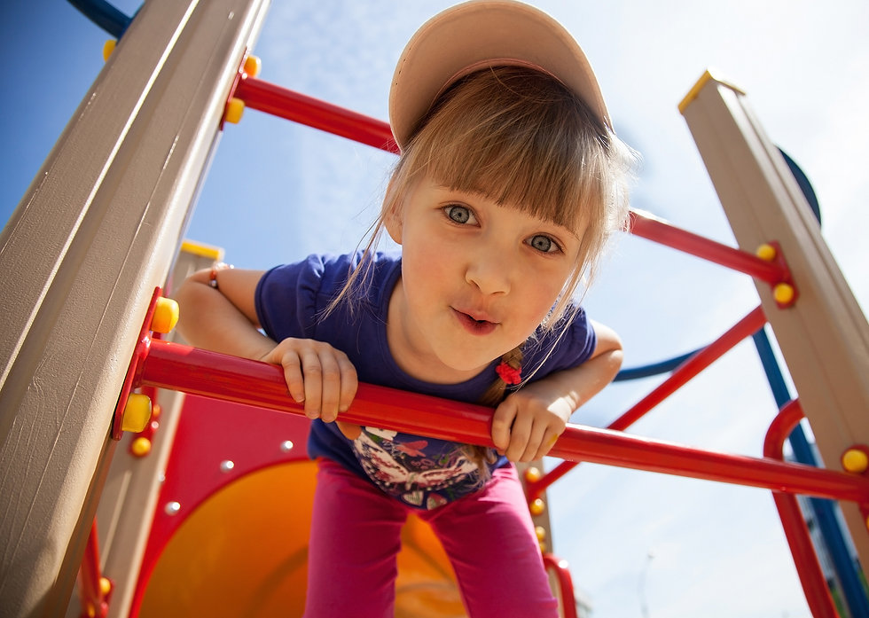 Active little girl on playground.jpg