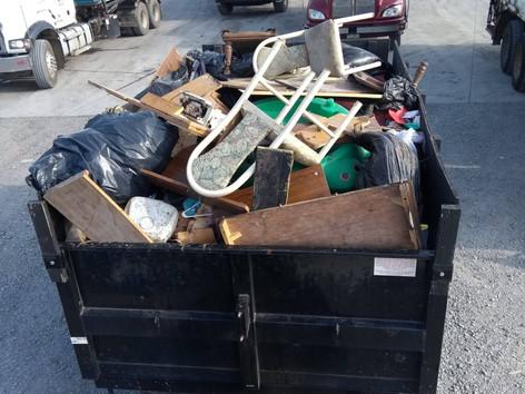 full trailer at the dump