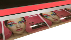 Mutoh XpertJet-1682SR eco-solvent printer with completed print and internal lights on