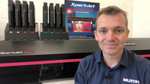 Stephen Crichton from Mutoh Australia sitting in front of XpertJet-1682SR eco-solvent printer.