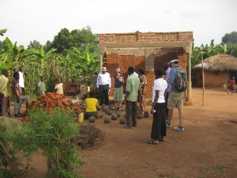 A new house in progress. We visited this potter in Uganda and they are slowly building the house that will also be a storefront. Bricks for the project are piled in the front yard.