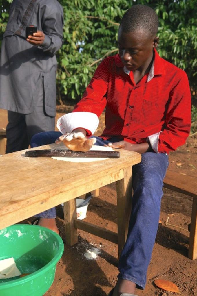 boy makes samosas in uganda