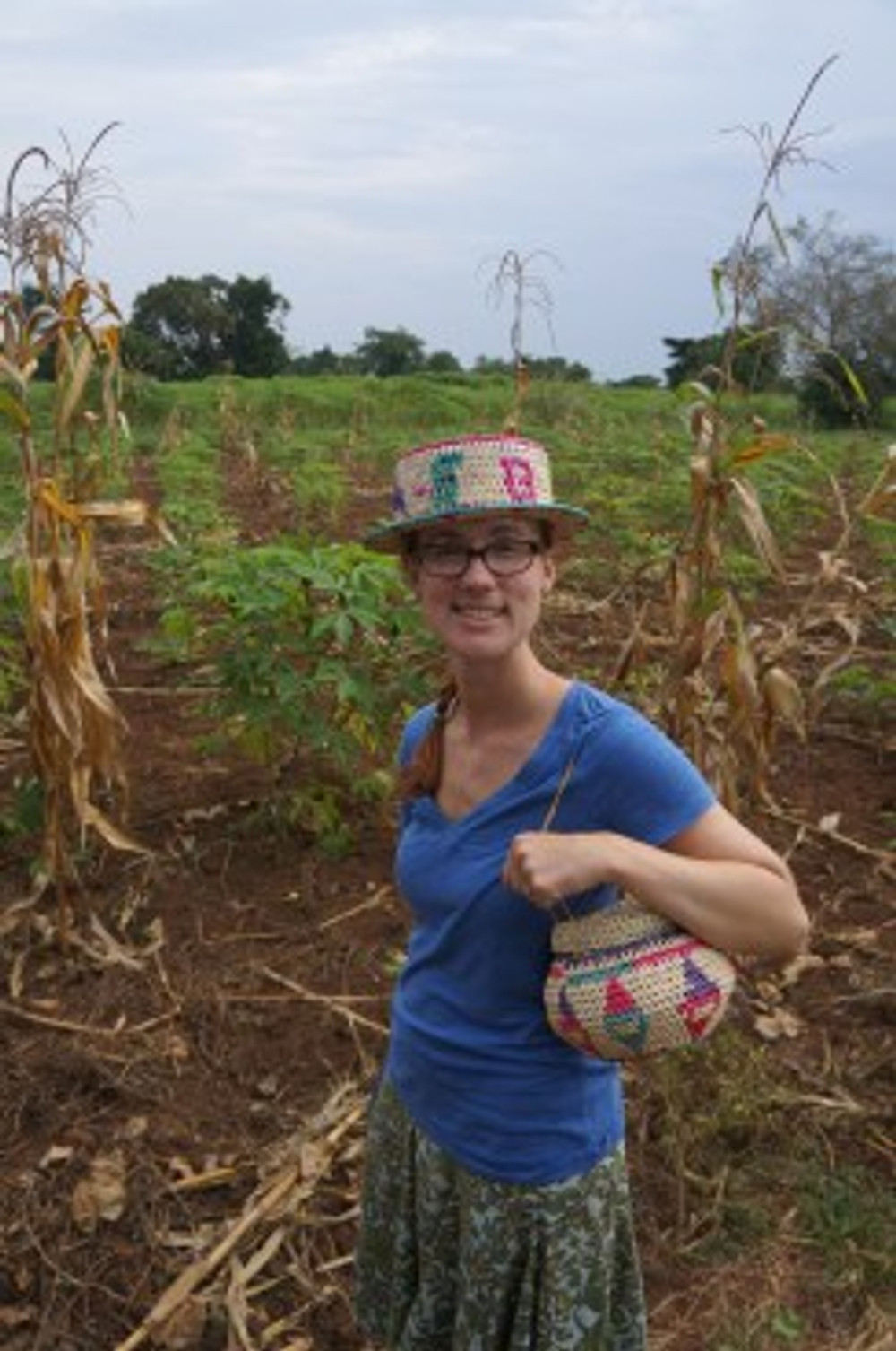 Tanya shows off a basket and hat woven by one of the Small Business Fund groups. I'm grateful for the generosity of our grant partners!