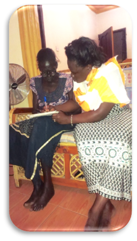 Naomi and Santa Enume reviewing the Small Business Fund materials.