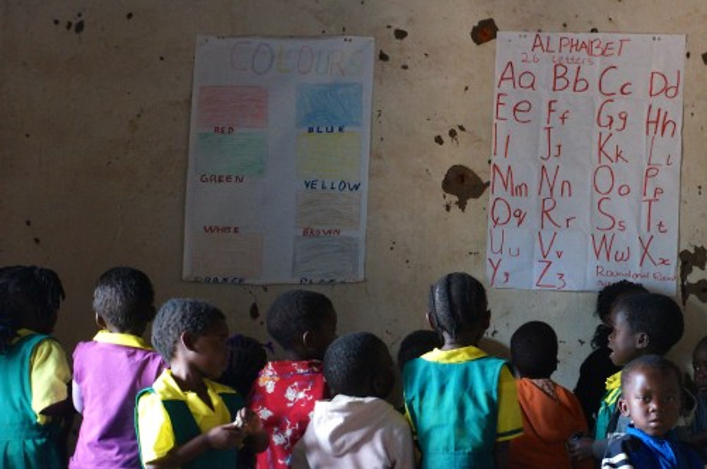 Children at Nellie's school recite their colors and ABC drills for us. The school started in January with just 7 children and it has already grown to over 50 students. Nellie has hired 2 other aids to help her with caring for and teaching the children.