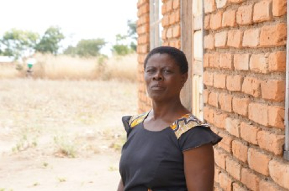 Harriet Mambo started her bakery business in 2006, after receiving a SBF grant. She had been recently widowed then. Now, she used profit from her bakery to build this house, which she rents out for $8 a month to a school teacher. (Malawi)