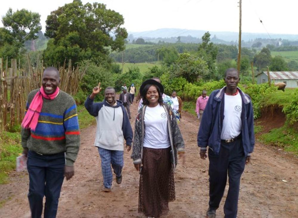 Coordinators walking on the muddy road.