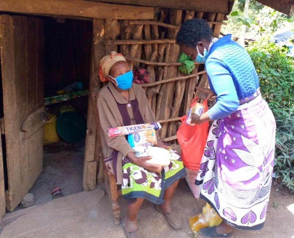 old woman receiving food