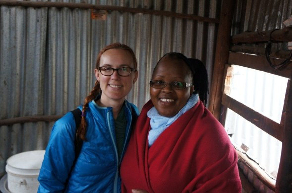 It was cold in Nairobi when we visited in July, 2014. I am wearing a light down jacket and Wambui (Small Business Fund Coordinator) is bundled up!